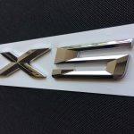 фото эмблема bmw x5