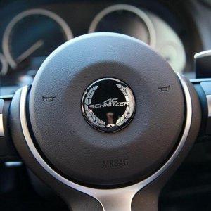 фото эмблема на руль BMW Shnitzer